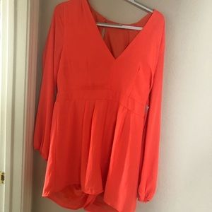 Orange short romper with Deep neck